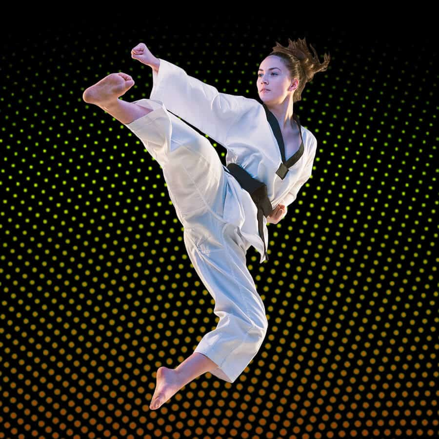 Martial Arts Lessons for Adults in King George VA - Girl Black Belt Jumping High Kick