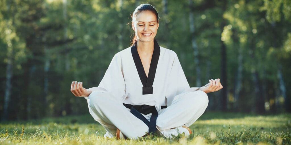 Martial Arts Lessons for Adults in King George VA - Happy Woman Meditated Sitting Background